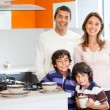 Stock Photo: Family having breakfast