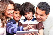 Family with a tablet computer — Stock Photo