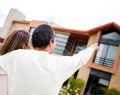 Couple pointing at their dream home — Stock Photo
