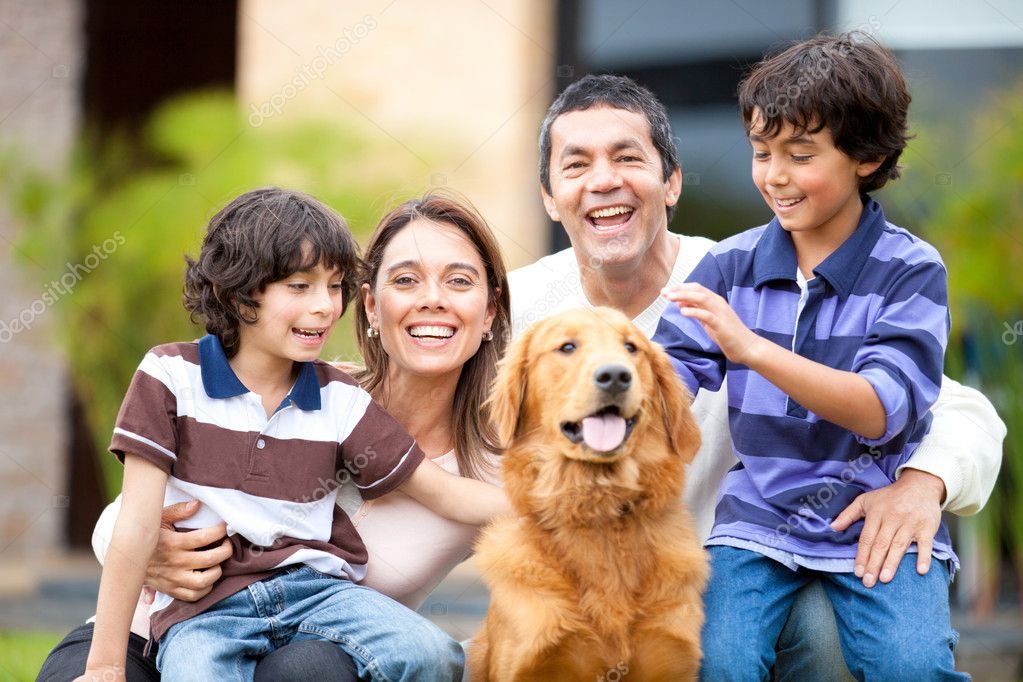 Family outdoors with a dog looking very happy — Stock Photo #10753955