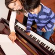 Boy in piano lessons — 图库照片