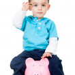 Stock Photo: Boy with piggybank