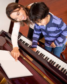 Boy in piano lessons — Foto Stock