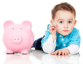 Saving money in a piggybank — Stok fotoğraf
