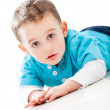 Boy lying on the floor - Stock Photo