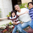Father playing with children — Stock Photo