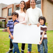 Family selling a house - Stock Photo