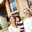 Beautiful family portrait smiling outside their new house — Stock Photo