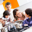 Family cooking together — ストック写真