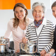 Women cooking at home - Stock Photo