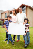 Family selling a house — Stock Photo