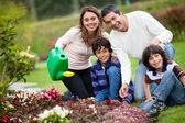 Family watering the plants — Stock Photo