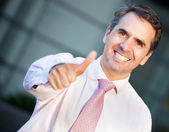 Businessman with thumbs up — Stock Photo