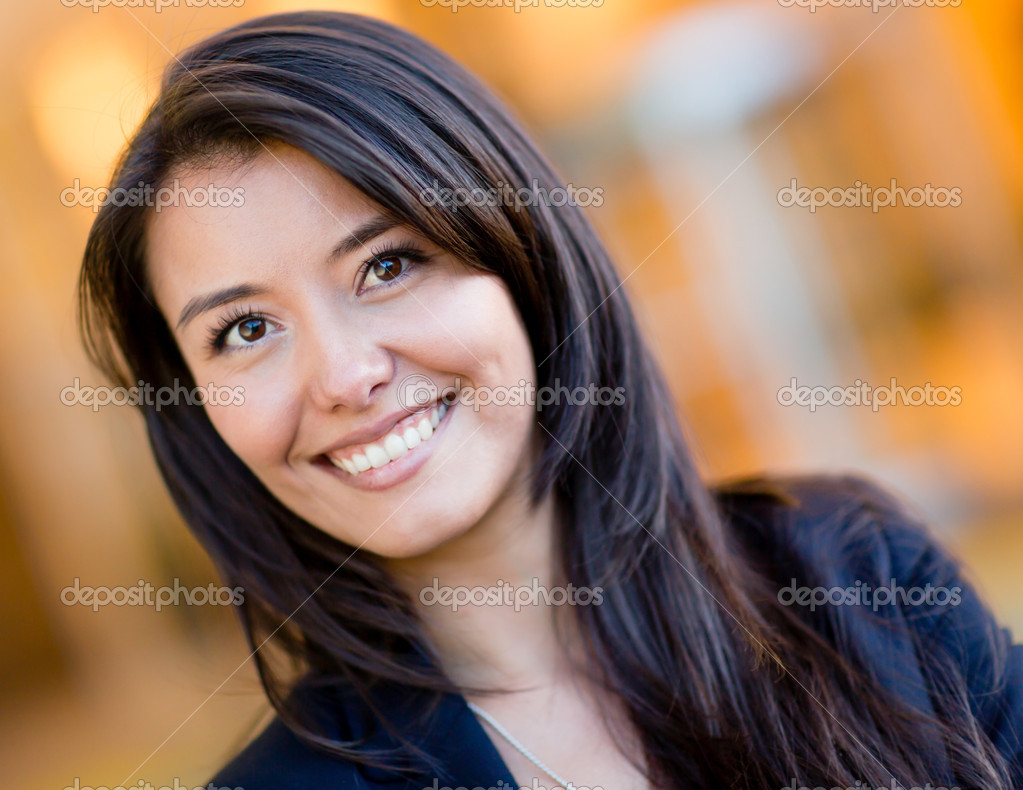 Portrait of a casual woman smiling and looking happy — Stock Photo #10842879