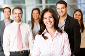 Business woman with her team — Stock Photo