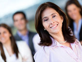Businesswoman with a group — Stock Photo