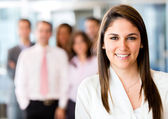 Woman leading business team — Stock Photo