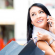 Shopping woman on the phone — Stock Photo