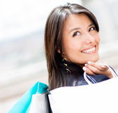 Pensive shopping woman — Stock Photo