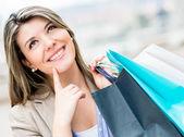 Nadenkend winkelen vrouw — Stockfoto