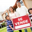 Latin family selling their house - Stock Photo