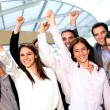 Business group with arm up — Stock Photo