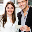 Couple holding a credit card — Stok fotoğraf