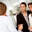 Loving couple checking in a hotel — Stock Photo