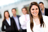 Woman leading a business group — Stock Photo