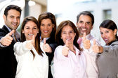 Business with thumbs up — Stok fotoğraf
