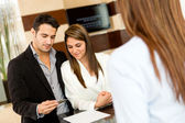 Couple doing check-in at a hotel — Stock Photo