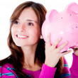 Stock Photo: Womholding piggybank
