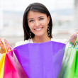 Happy woman with purchases — Stock Photo #10986096