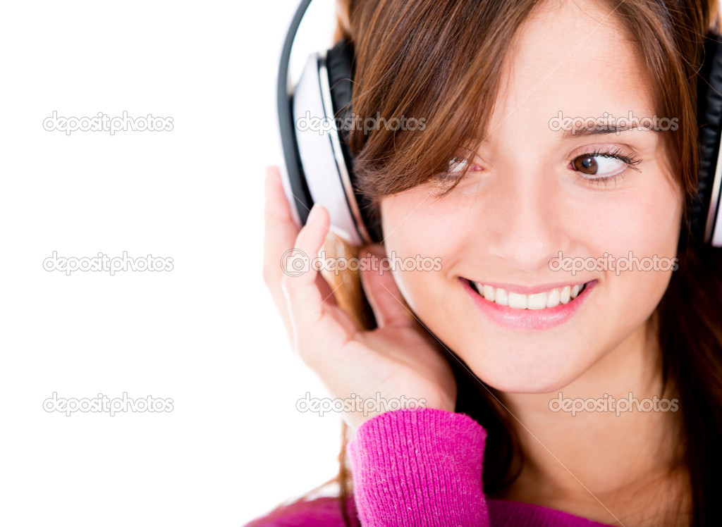 Woman listening to music with headphones - isolated over white  Stock Photo #10985954