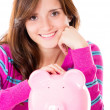 Stock Photo: Woman saving money