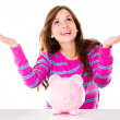 Stock Photo: Womwith piggybank