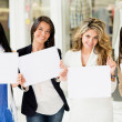 Women holding banners — Stock Photo