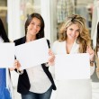 Women holding banners - Stock Photo