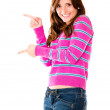 Happy woman pointing — Stock Photo