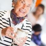 Elder woman drinking coffee — Stock Photo
