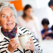 Old woman with a cup of tea — Stock Photo