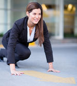 Business woman ready to race — Stock Photo
