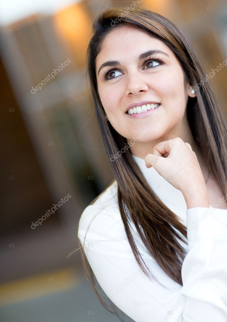Portrait of a pensive businesswoman looking up and smiling — Stock Photo #11029625