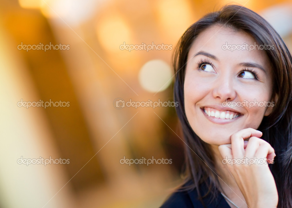 Portrait of a thoughtful woman looking up and smiling — Stock Photo #11029665