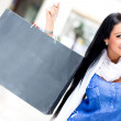 Woman holding shopping bag — Stock Photo #11045646