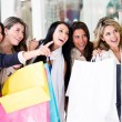 Stock Photo: Group of friends shopping