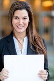 Businesswoman holding documents — Stock Photo