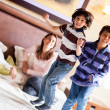 Kids jumping on the bed — Stock Photo