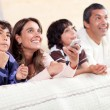 Stock Photo: Family watching tv
