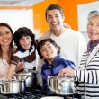 Stock Photo: Family cooking at home